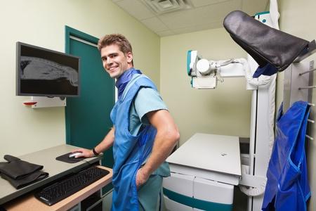 Radiologist examining  dog's x-ray in examination room photo