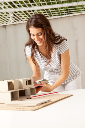 functionalism: A young female architect choosing color swatches for a building