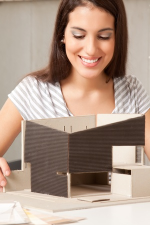 A young design student or architect building a house model Stock Photo - 9282757