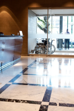 medicine wheel: An hospital entry with wheel chair and reception Stock Photo