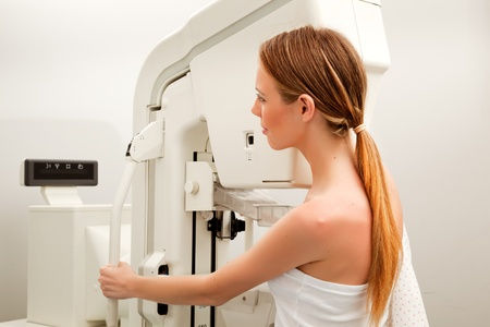 A young woman taking a mammogram x-ray test Stock Photo - 9330690
