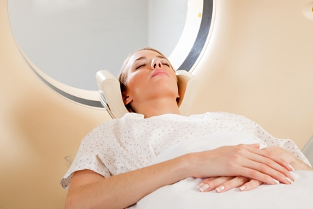 A young female taking a CT scan - medical testing Stock Photo - 9323193