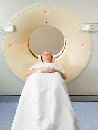 A young woman undergoing a CT scan in a hospital photo