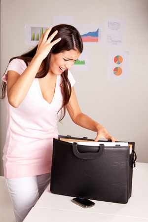 A stressed women who is looking for a lost document photo