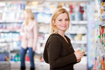 A young woman buying groceries in a grocery store photo