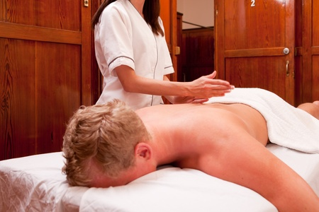 therapeutic massage: A man receiving a percussive massage at a spa