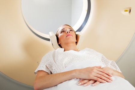 A horizontal image of a woman with eyes open taking a CT scan Stock Photo - 9359267