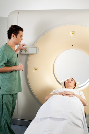 A patient and CT Scan Technician preparing for an x-ray Stock Photo - 9359266