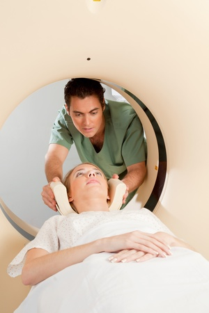 A young woman having a CT scan taken - Nurse getting things prepared Stock Photo - 9359231