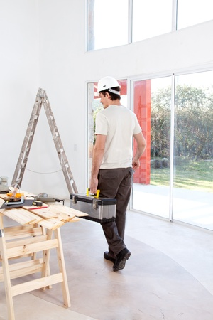 A faceless man with a tool chest, working on home improvements Stock Photo - 9359289