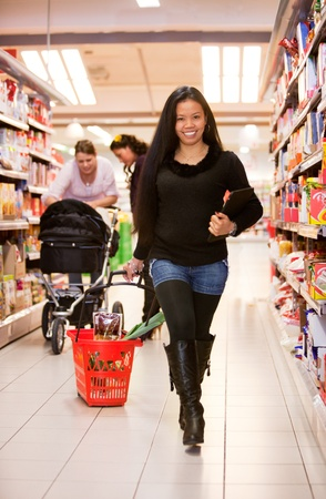 An asian woman in a grocery store  photo