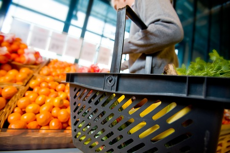 A detail of a man shopping for fruits and vegetables Stock Photo - 9359418