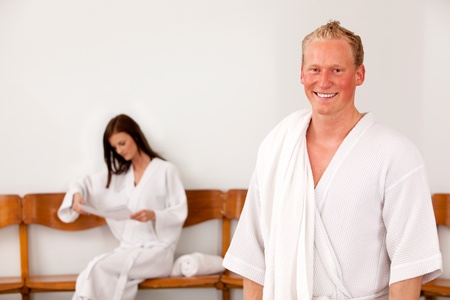 Portrait of a man at a spa with a woman in the background photo