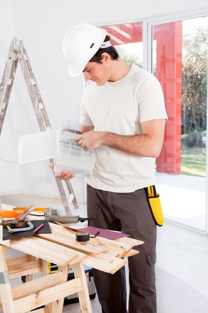 craftman: A man looking for a screw, doing home improvements