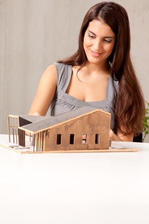 A female architect building a rough house study model photo