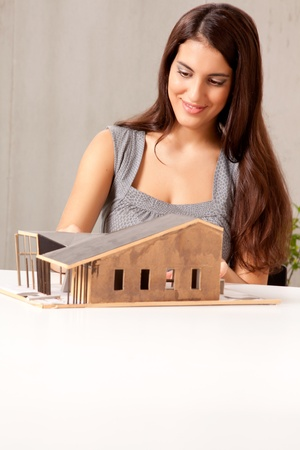 functionalism: A female architect building a rough house study model