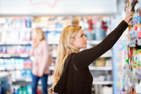 Young woman shopping in the supermarket Stock Photo - 9470674