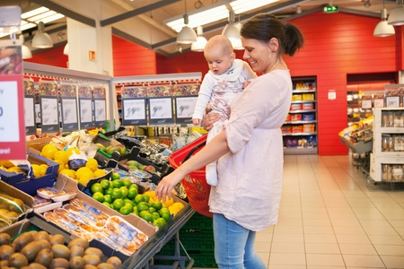 superstore: Mother and child shopping in supermarket