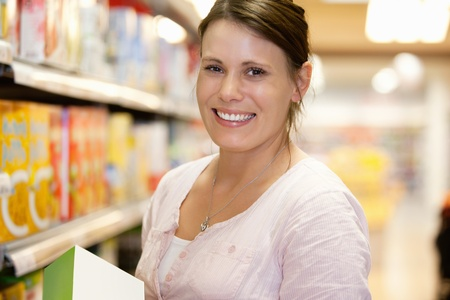 Close-up of a shopper in shopping centre smiling and looking at camera Stock Photo - 9470550