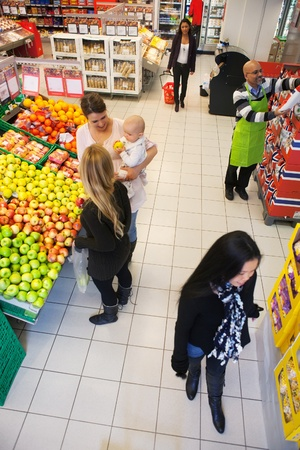 High angle view of people buying in supermarket photo