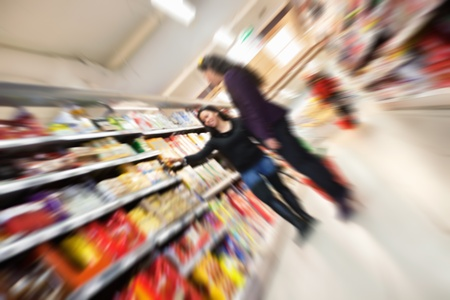 Tilted blur image of women shopping in shopping in shopping centre Stock Photo - 9599816