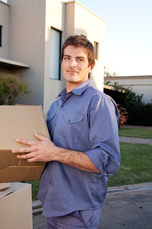 Portrait of a serious man outdoors with cardboard moving boxes Stock Photo - 9600101