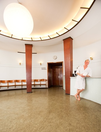 a man in a bathrobe in a 1920's functionalism styled spa Stock Photo - 9600041
