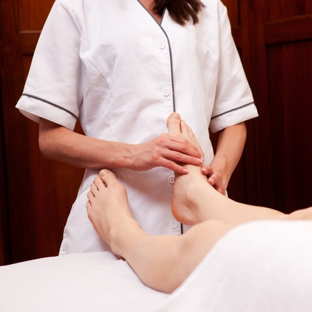A woman receiving a foot massage at a spa photo