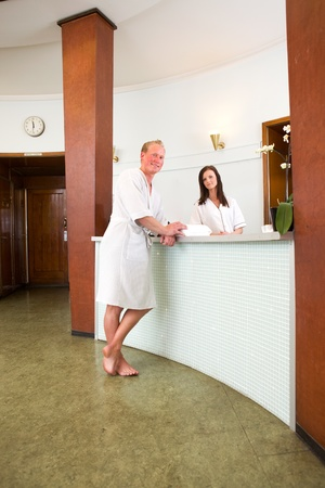 A customer in a spa reception in a bathrobe photo