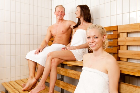 Portrait of a woman with friends in a sauna photo