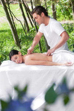 Beautiful young woman getting massage from a therapist photo