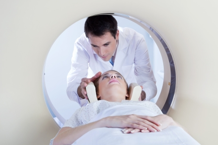 Technologist preparing the patient for a CT scan in hospital photo