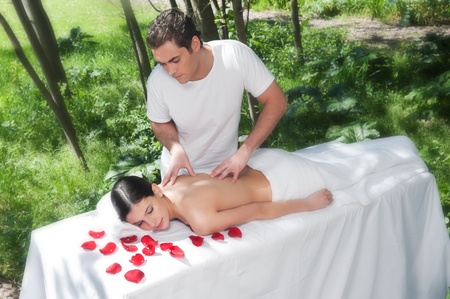 Beautiful woman getting massage and spa treatment in natural setting Stock Photo - 9887229