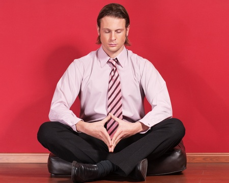 Relaxed businessman sitting on the floor photo