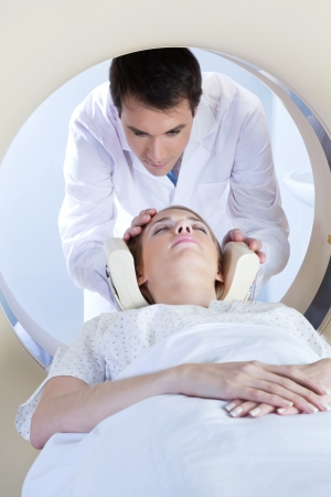 Doctor preparing the patient for MRI scan test photo