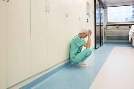 remorse: Upset surgeon sitting alone after she failed an operation