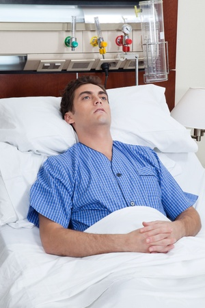 An severe male patient at hospital bed photo