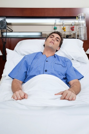 unease: An severe male patient at hospital bed