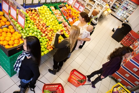 High angle view of busy people shopping in supermarket