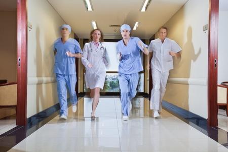 Team of surgeon and nurse running in hallway of hospital Stock Photo - 9887297
