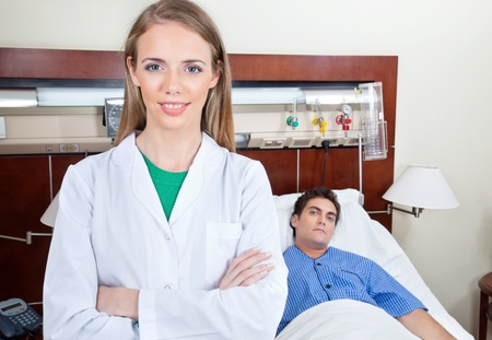 Confident female doctor with patient in hospital photo