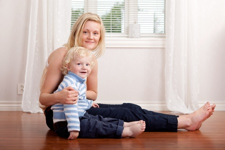 Portrait of a mother and son sitting in the living room Stock Photo - 9887555