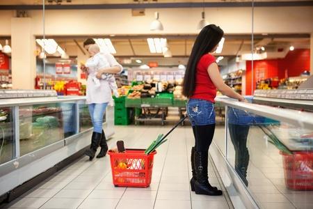 Full length of women shopping in shopping in shopping store photo