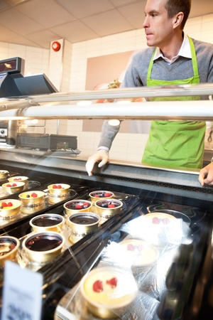 Pastry for selling in the supermarket with market assistant in the background Stock Photo - 9887402