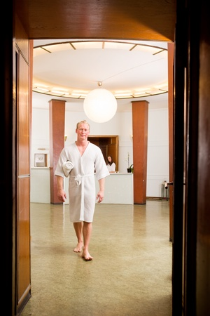 A man in a luxurious old style spa interior photo