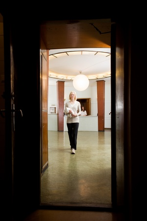 Portrait of a female customer in an old 20s functional style spa photo