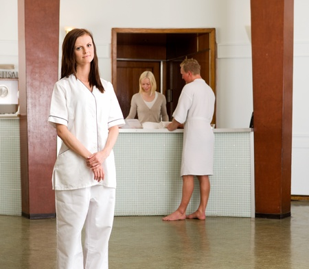 Portrait of a spa therapist worker standing in a recption photo