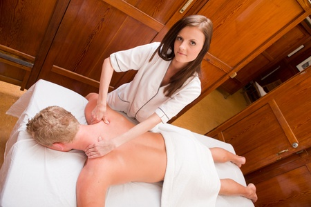 Overhead portrait of a massage therapist gives a massage in an old style spa photo