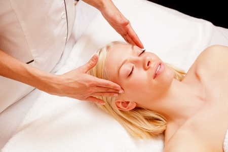 scalp: Portrait of a woman in a spa receiving a scalp massage Stock Photo