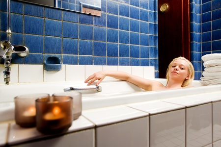 women bathing: A beautiful blond in an original 1920s style spa and bath